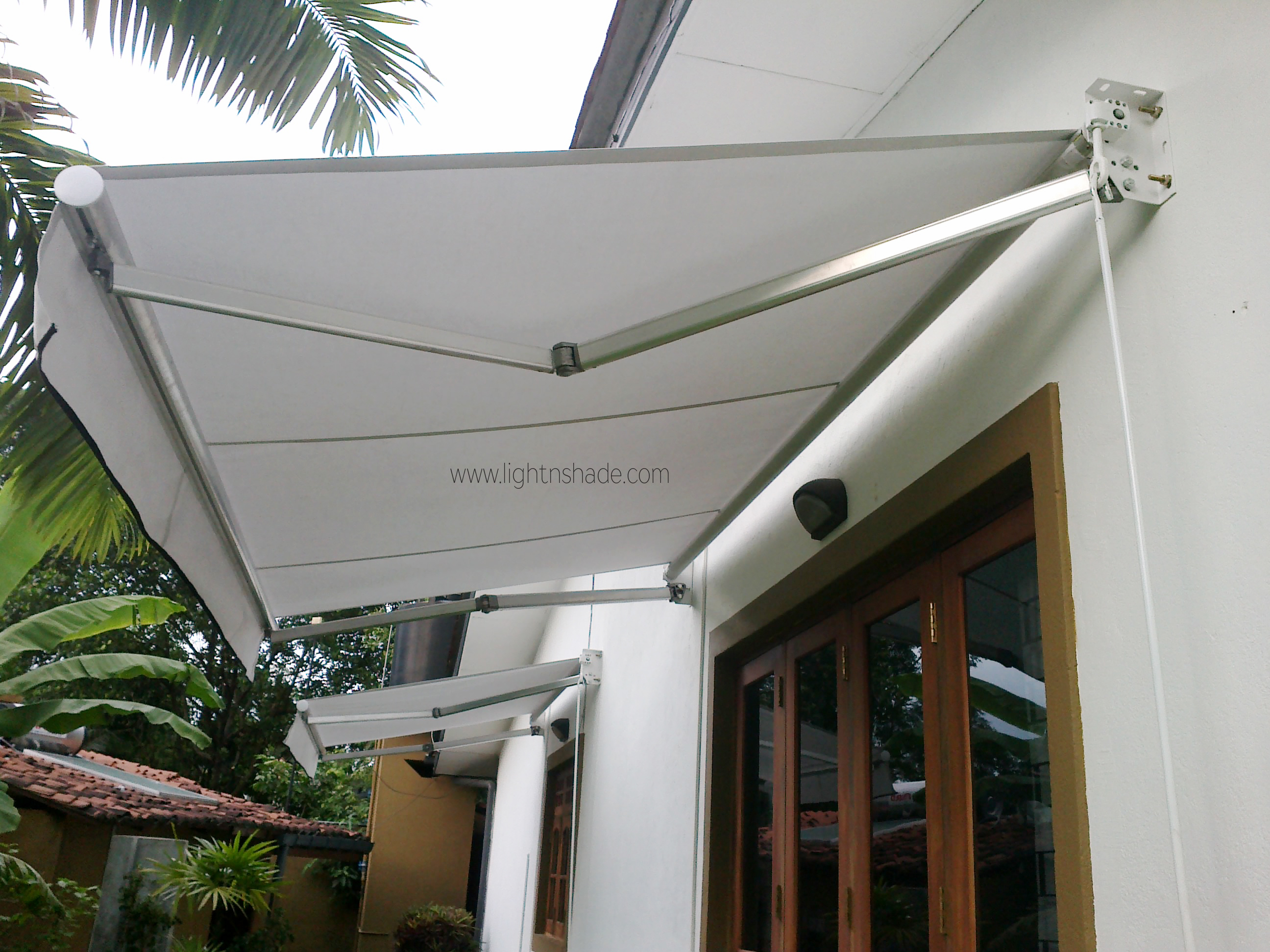 two tones a large function use pin interest the of fabric creative shade awnings adds for colors way decorative very and this in shading awning areas is sail